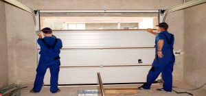 Men Installing A Garage Door-Garage Door Repair
