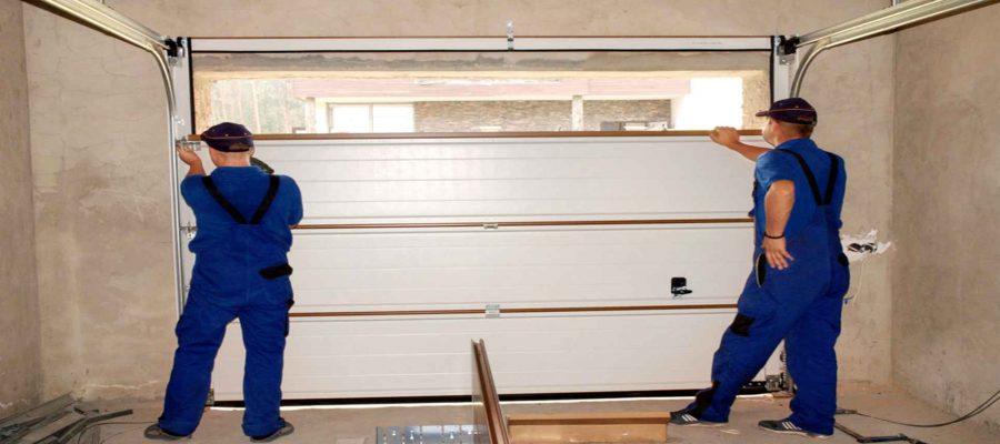Men Installing A Garage Door-Garage Door Repair