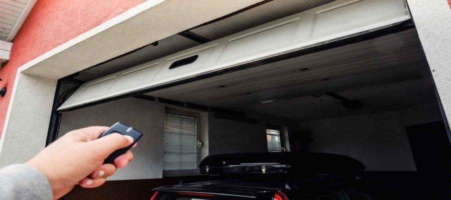 Person Using Garage Door Opener To Open Garage-Garage Door Opener Repair