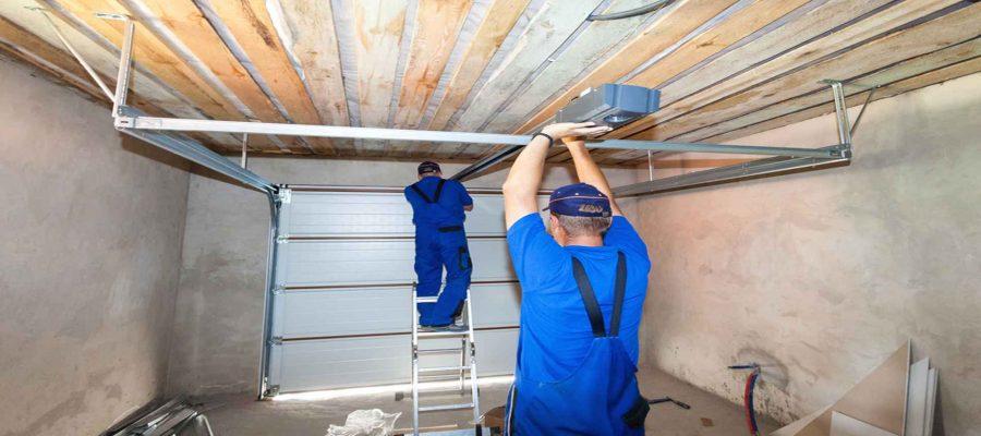 Two Men Fixing Garage Door Panels-Garage Door Panel Replacement